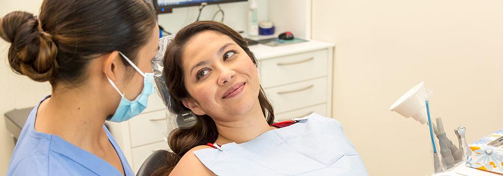A pregnant mom is shown at the dentist's office using her enhanced benefits through HMSA