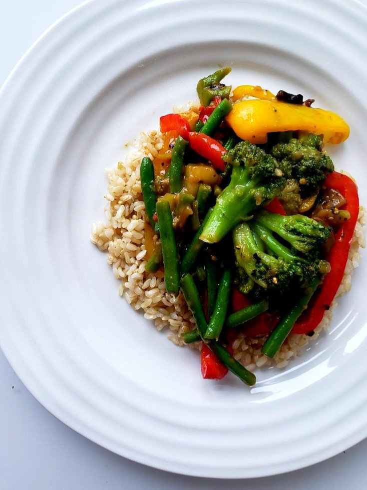 Plate with vegetable stir fry with rice