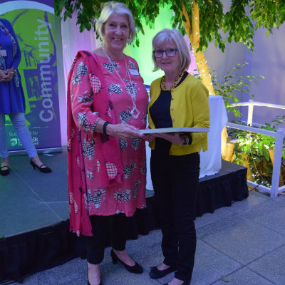 Marie-Anne MacKenzie (Highpoint North Prison Library) receives her Library Volunteer award from Suffolk Libraries Board vice chair Sylvia Knights
