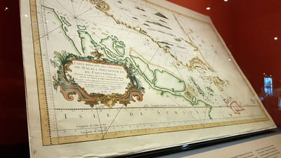 A photo of an old nautical map on display.
