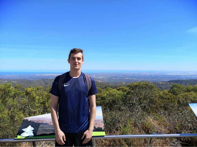 Myself stood on top of the tallest hill in Adelaide, with a view of grasslands and Adelaids's central business district far in the background.