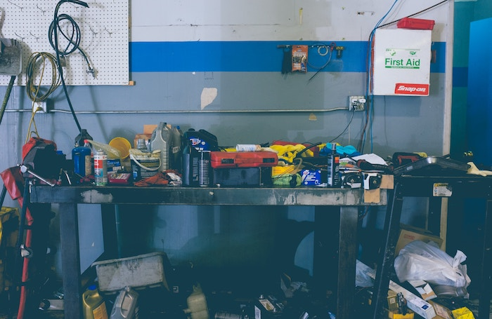 image of cluttered garage workspace