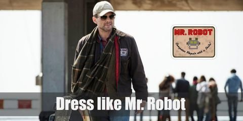 Speaking of Mr. Robot's outfit, his drifter-like outfit seems pretty natural, considering his illegal acts. His non-striking look is characterized by numerous pieces of worn, sometimes even dirty clothes.