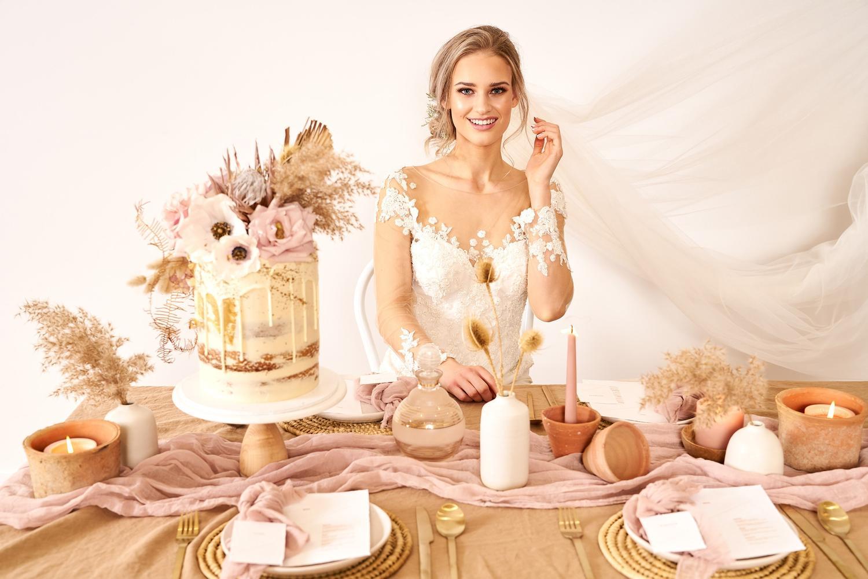Bride posing at table