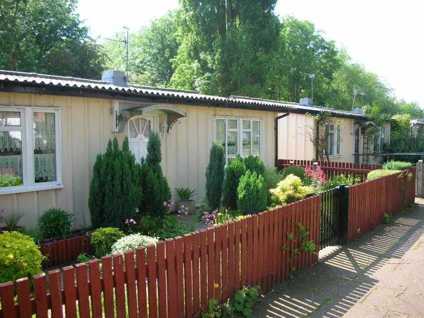 A row of United Kingdom post-War prefab houses, this one built by a company called Phoenix, from Wikipedia.