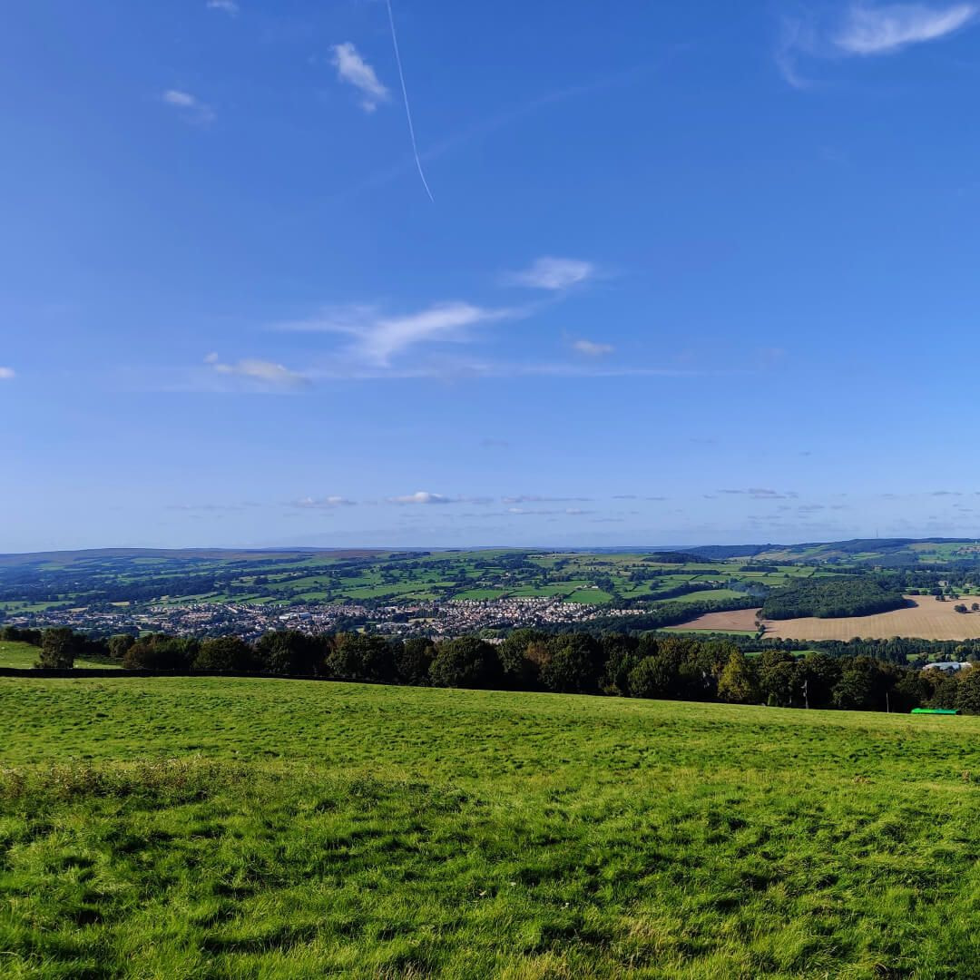 View over Otley Chevin Forest Park from a grassy field