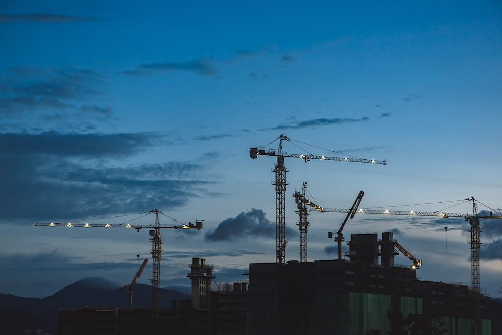 Cranes at night - Photo by EJ Yao on Unsplash