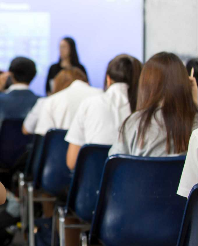 Students attend a presentation.