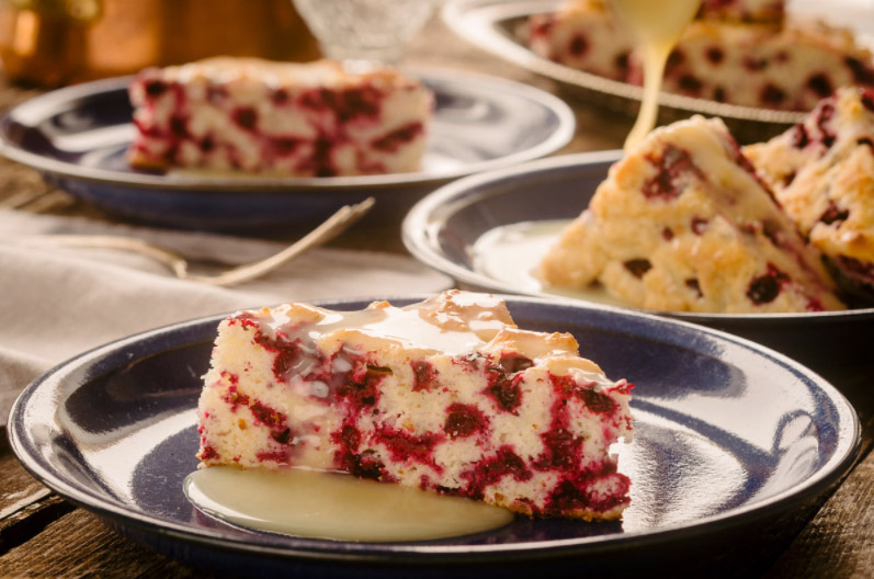 slice of cranberry cake on a white plate