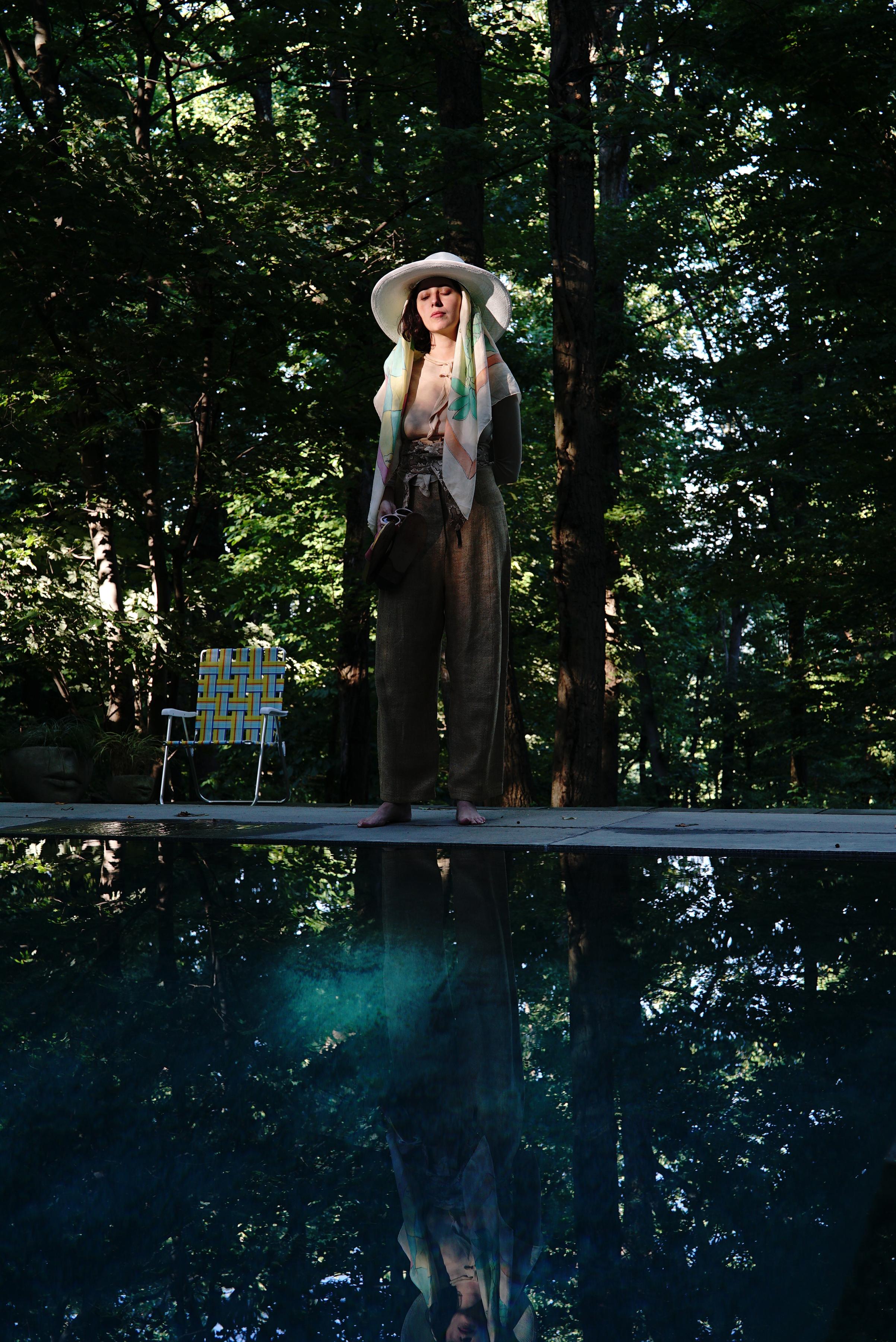 Maria Usbeck stands near a pond