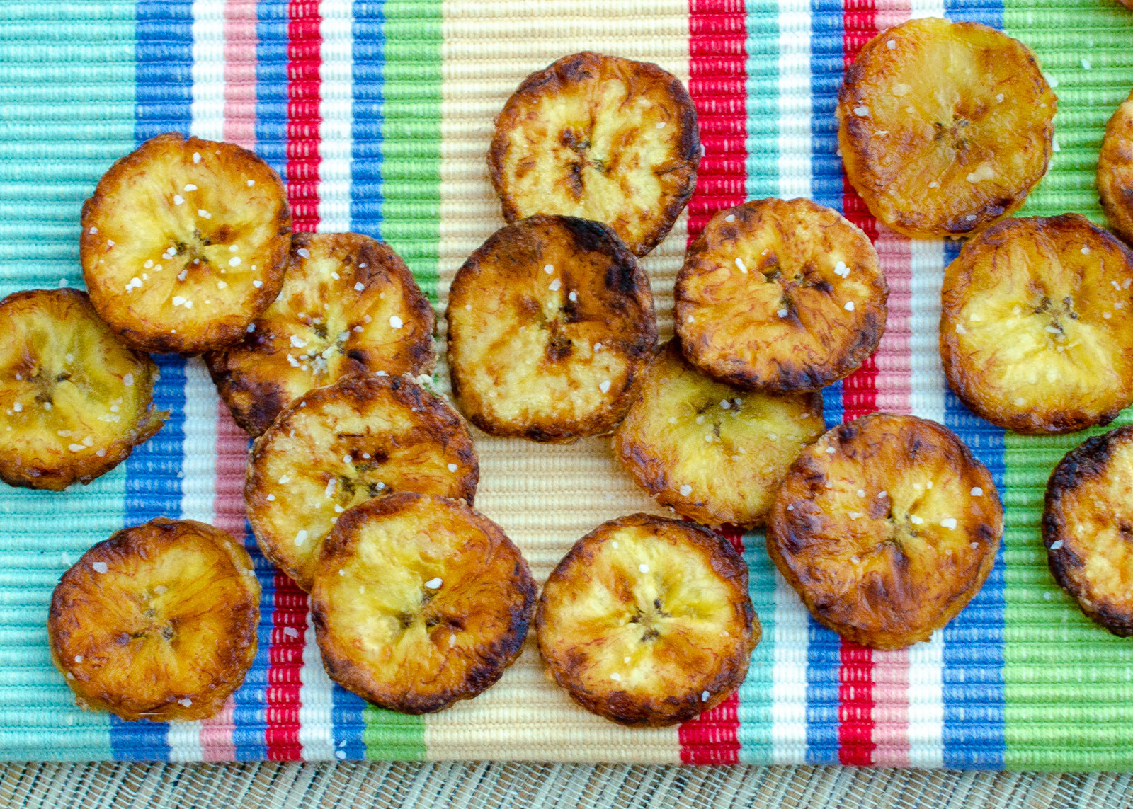 fried plantain slices on a colored background