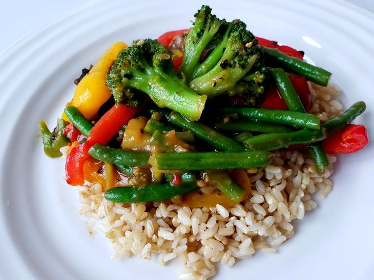 Plate with stir-fry vegetbales over rice