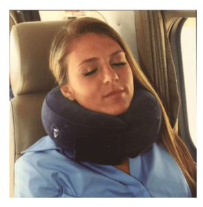 Woman with neck pillow on a flight