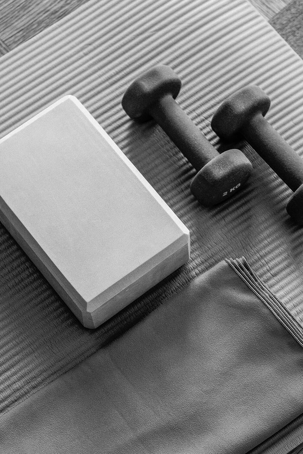 Yoga brick and dumbbell weights