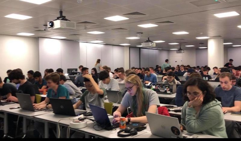 Attendees tackling the coding challenge