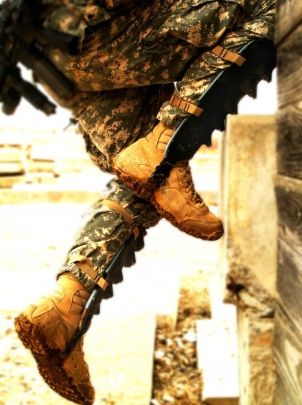 A midrange shot of a soldier wearing two shin guards, allowing her to scale heights in a combat setting.
