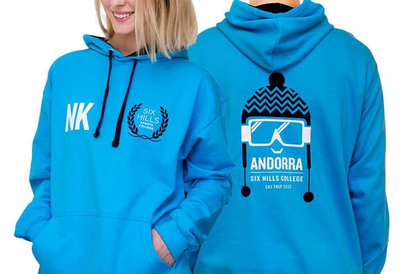 ski hoodies with a school logo and ski trip design printed on the back