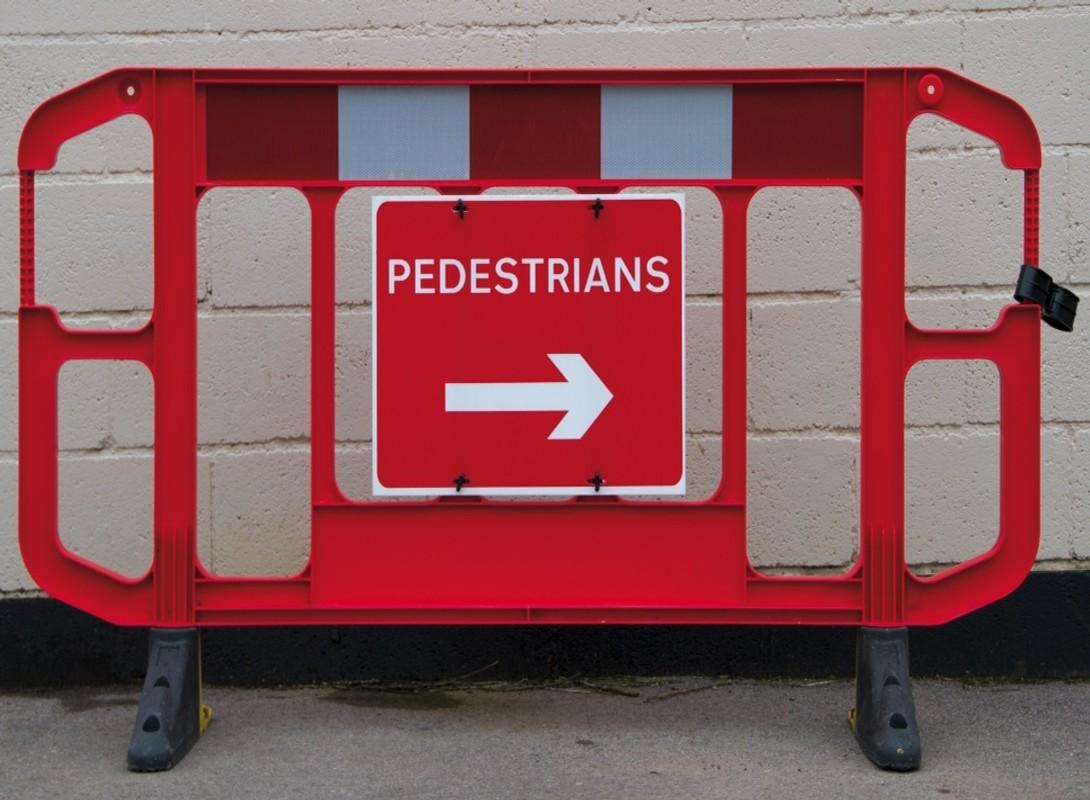 Titan barrier with pedestrian sign