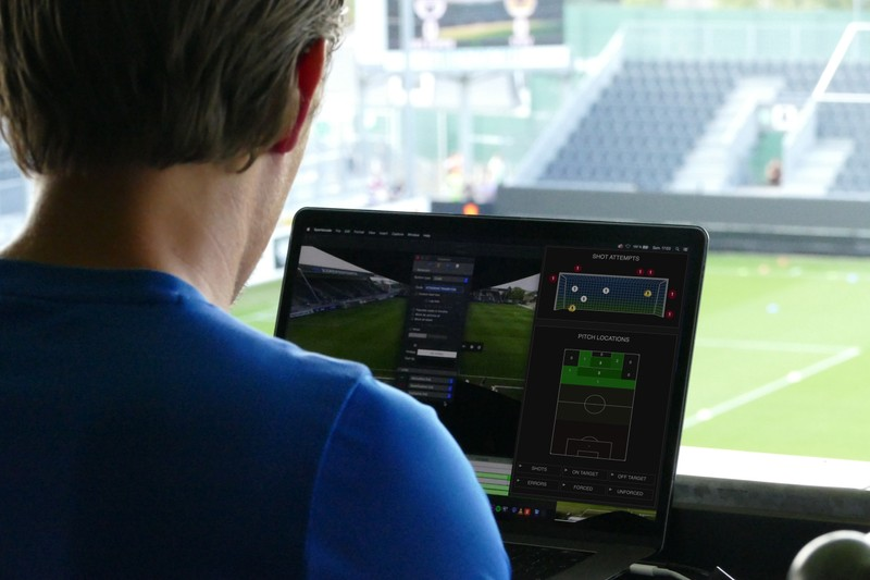 Man analyses goal attempts and player positioning on monitor