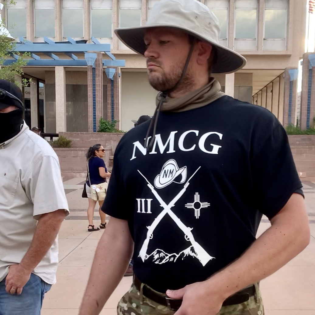 Another member of the New Mexico Civil Guard wearing the racist militia's official t-shirt. Photo by Bella Davis.