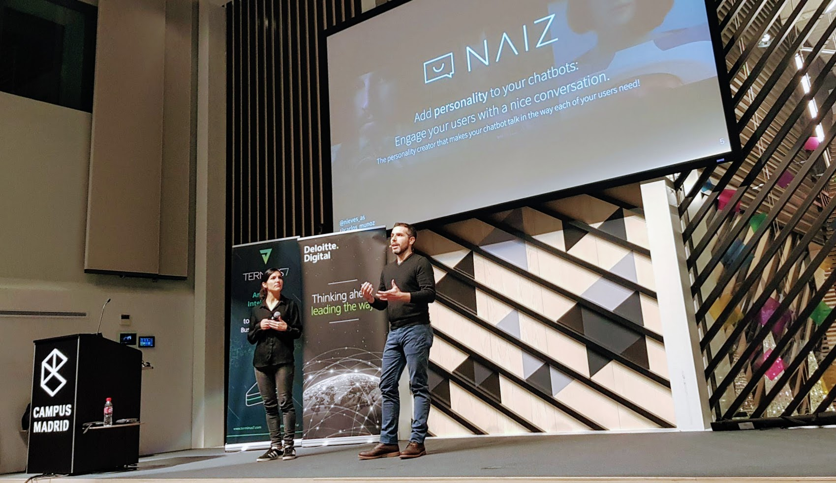 Carlos and Nieves talking about NAIZ at madrid.city.ai event in Google Campus Madrid.