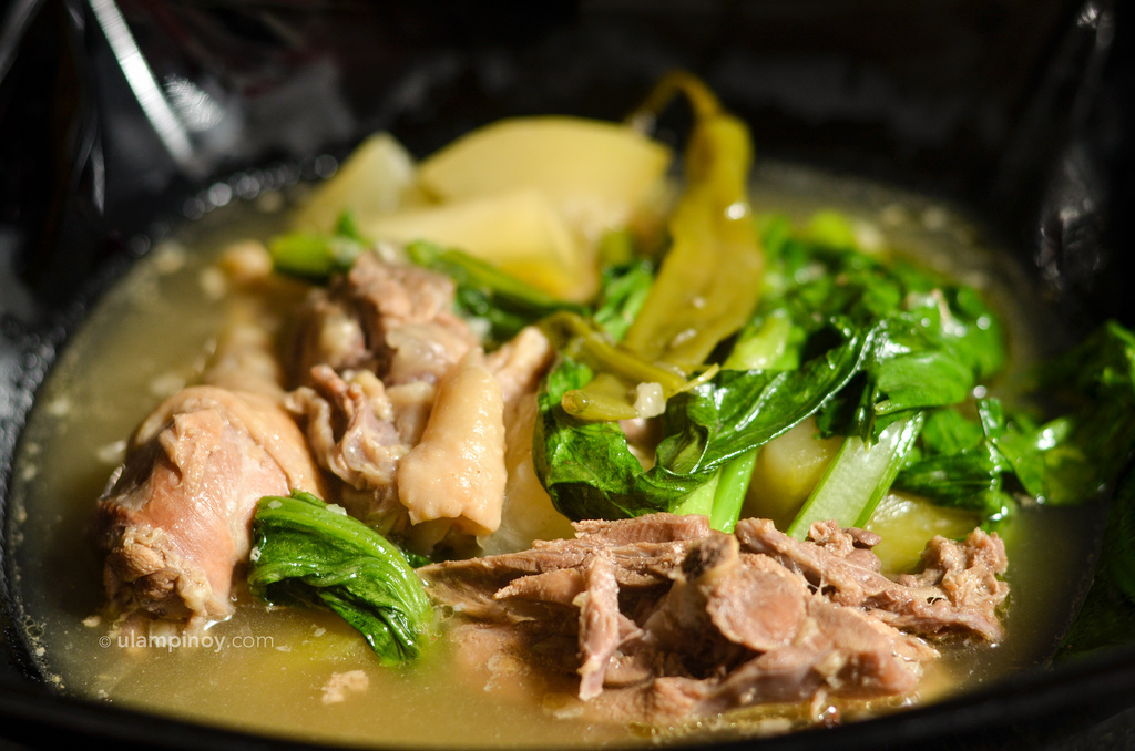 chicken bones and malunggay stalks as A delicious soup with malunggay which, whether it's relevant or not, is being pushed to be declared by law to be named the philippines's national vegetable.