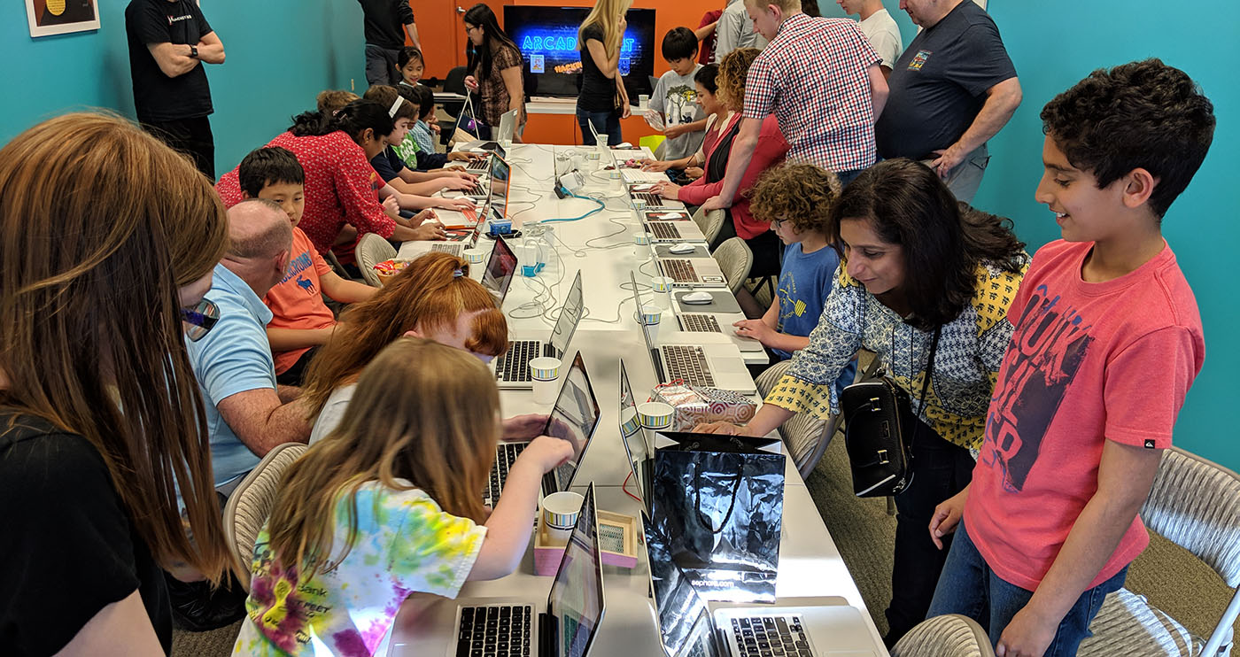 students participating at a family-coding event at the Hackingtons Rocklin location