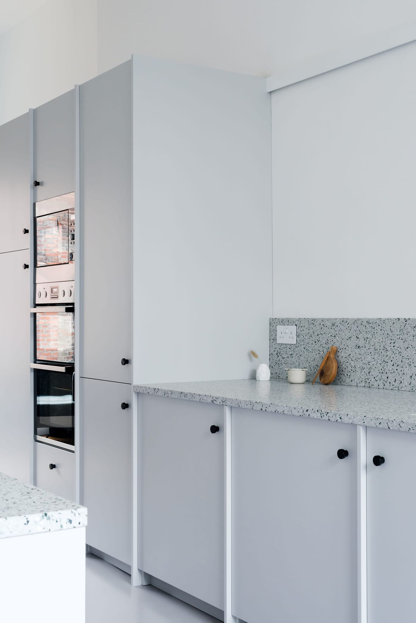 Bespoke kitchen designed by From Works of light grey cabinets and terrazzo worktop in Kelham Island, Sheffield.