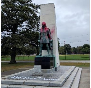 defaced Columbus statue