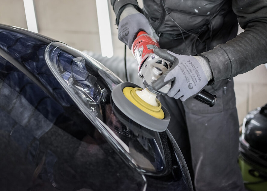 Car lights going through headlight restoration service