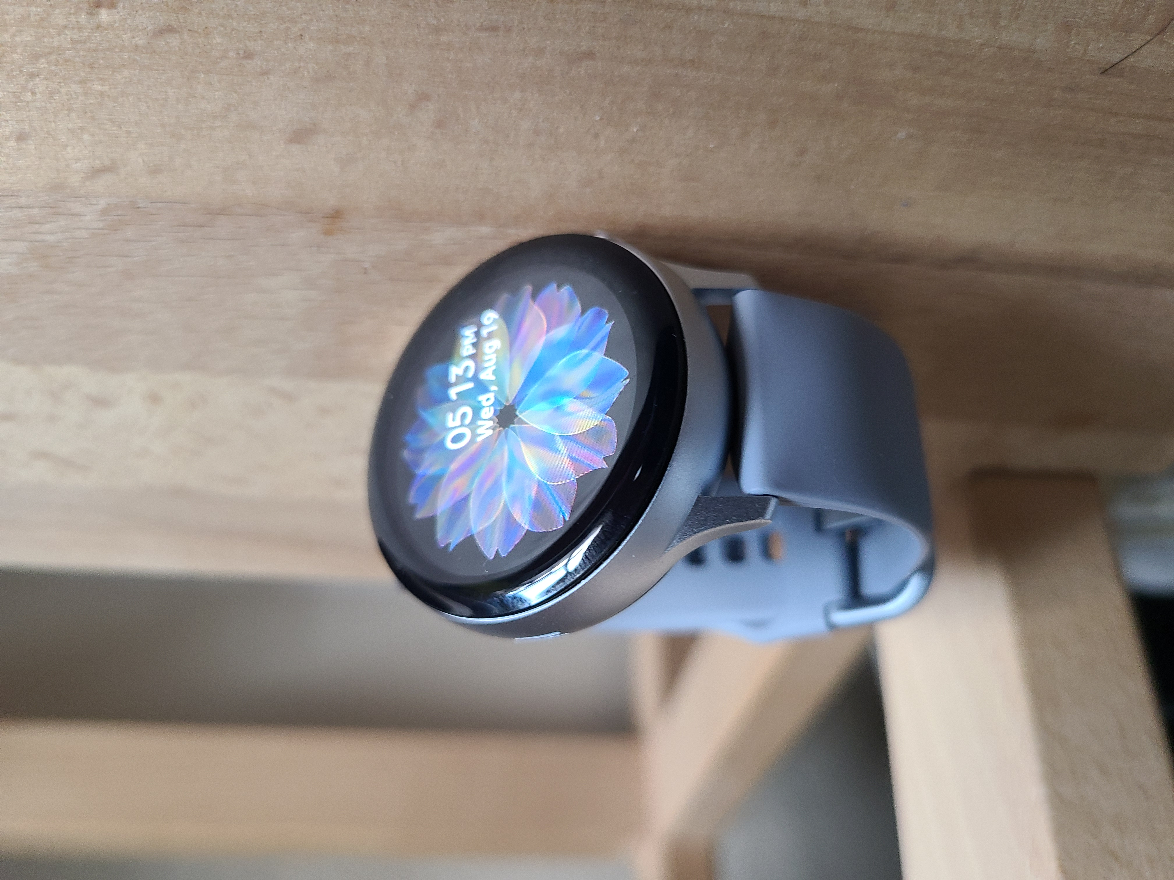 Samsung Galaxy Watch Active 2 with the live wallpaper watch face