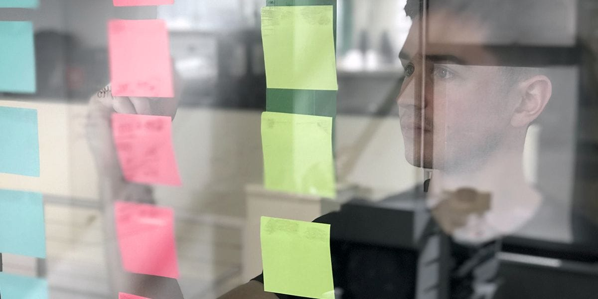 Designer Chapman planning on sticky notes