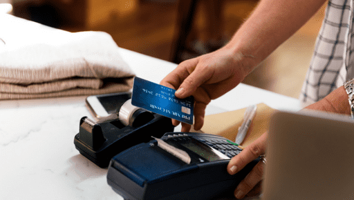 Customer uses card on card machine on till of store business. Business owner uses top KPIs for retail store business #business