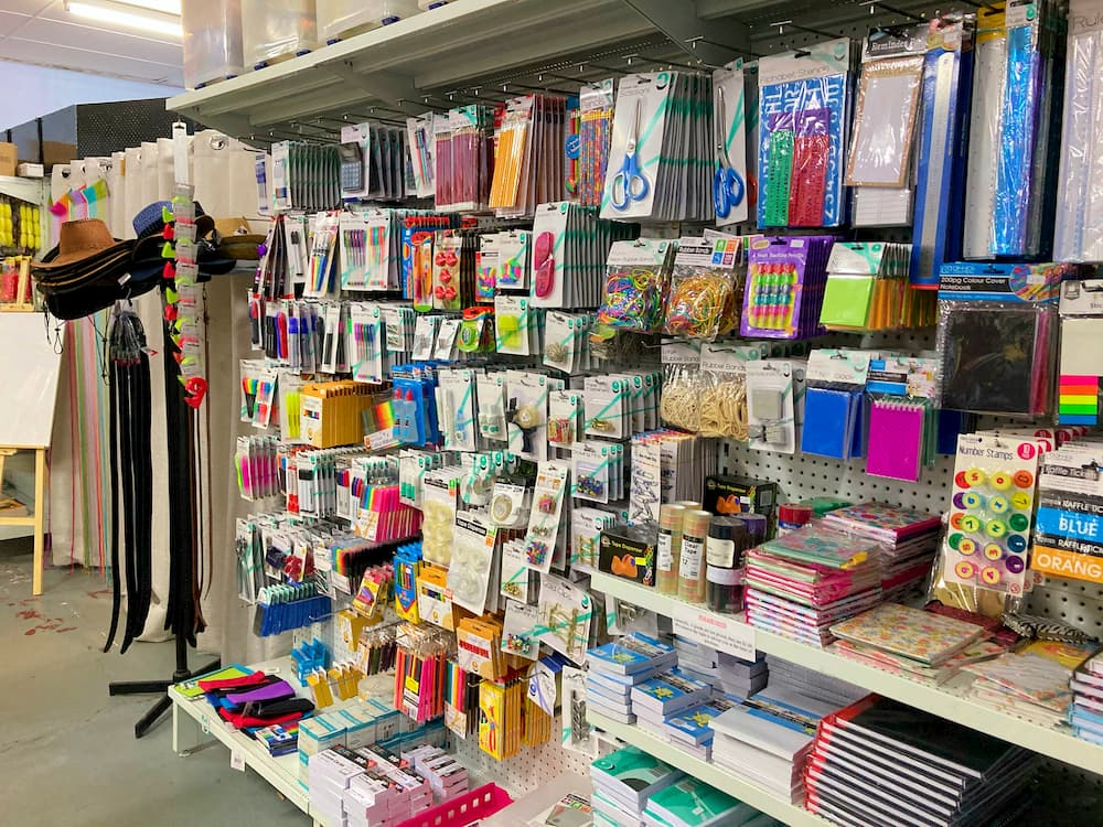 Hats and leather belts. Stationary products, including notebooks, pens, scissors, highlighters, sticky tape, stamps, rubber bands, pencil cases, and more.