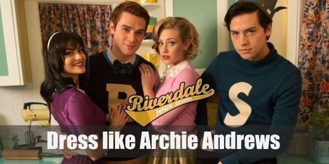 Archie Andrews wears a blue and yellow varsity jacket on top of a white, V-neck t-shirt. Blue jeans and lace-up, fashion sneakers.