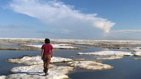 Christina Bonsell walks on broken ice