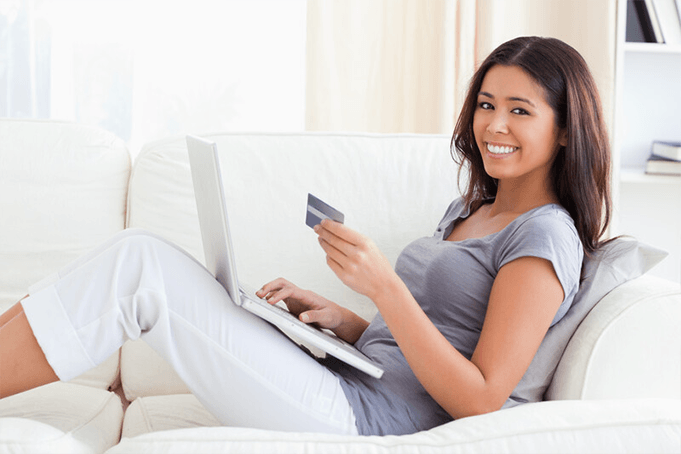 A women happy that she is taking control of her debt