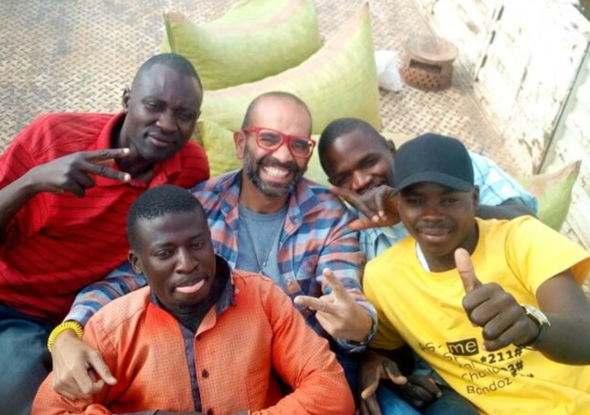 Ashish posing with a group of men