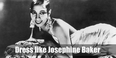 """For the perfect Josephine Baker costume, you will have to have lots of jewels, fur, feathers, as well as a beautiful and form fitting dress."""