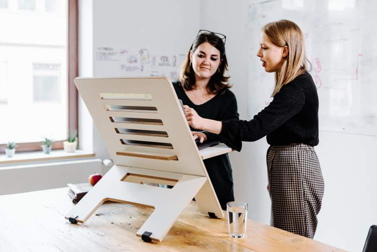 An image of two business women working together.