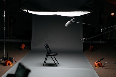 A video production studio, darkly lit