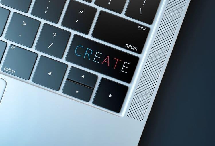Laptoptastatur mit dem Schriftzug Create