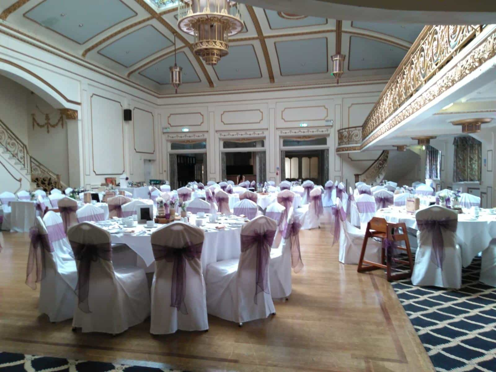 Grand room wedding breakfast with gold and white decor