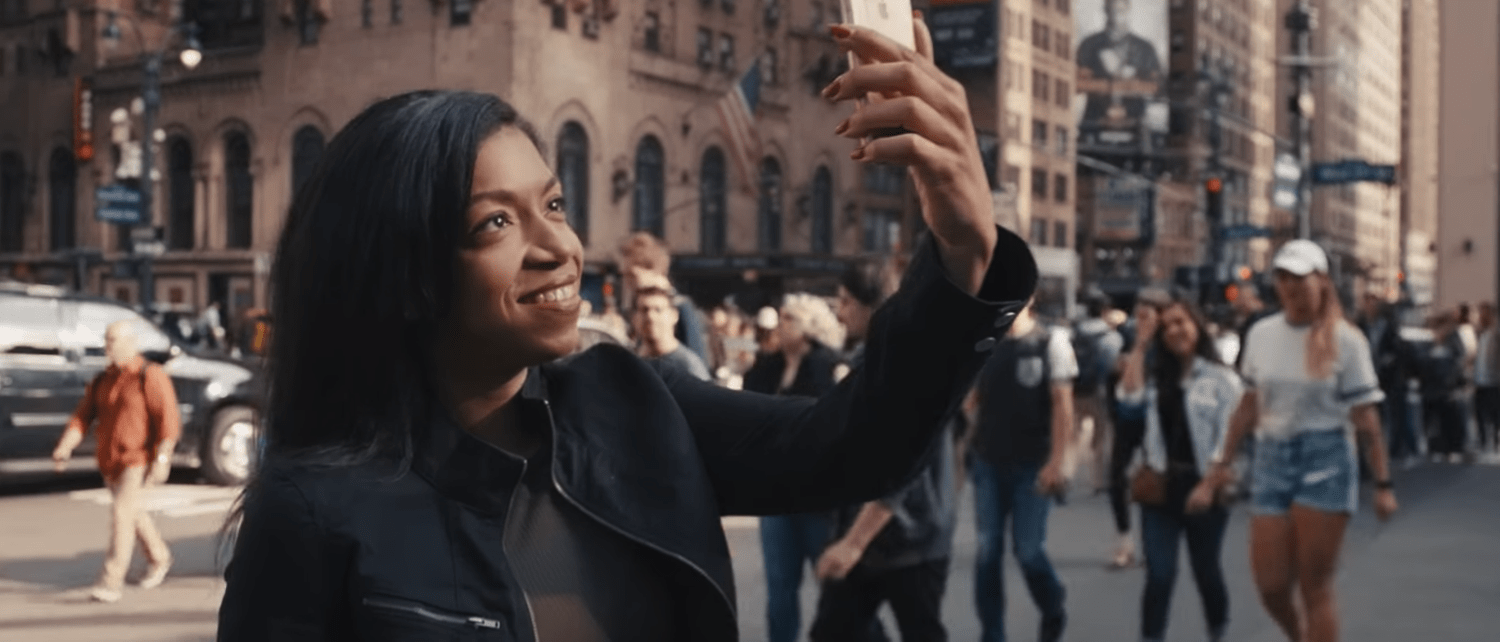 Person standing on the street taking a selfie
