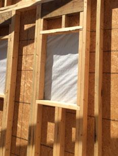 Photo of wall framing with a window towards the top, and cripples underneath for support, from Less Everything.