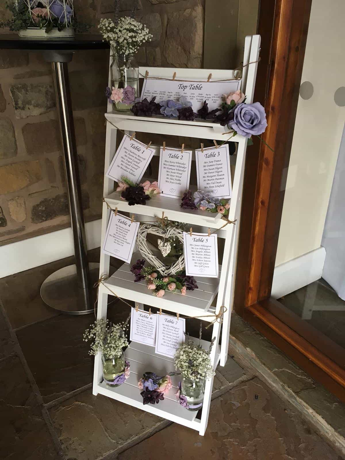 Wedding ladderstand with seating numbers for guests to see where they will sit