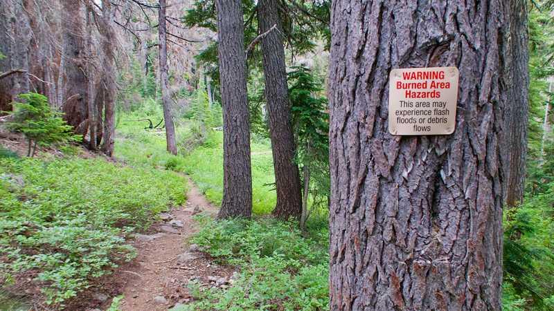 A sign warns of a burn area ahead