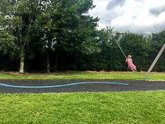 Ayla enjoying a fun zip line slide before we set out for the day.