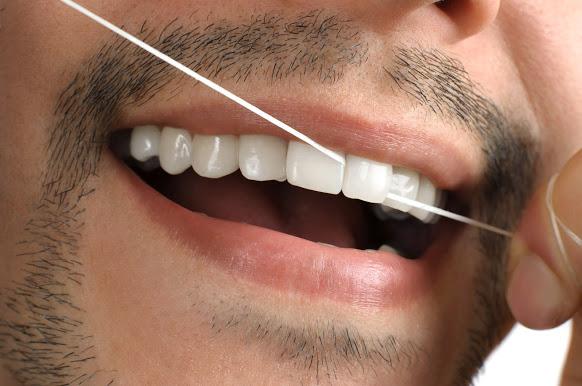 fio dental e higiene bucal