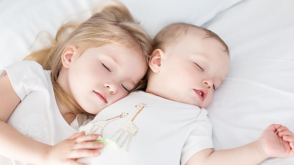 Sister and brother sleeping together